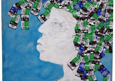 Title- Head Series No. 2. Artist-Taiye Idahor. Year- 2012, Medium- Film Cartridge, newspaper and acrylic paint on wood. Size- 61cmx 61cm